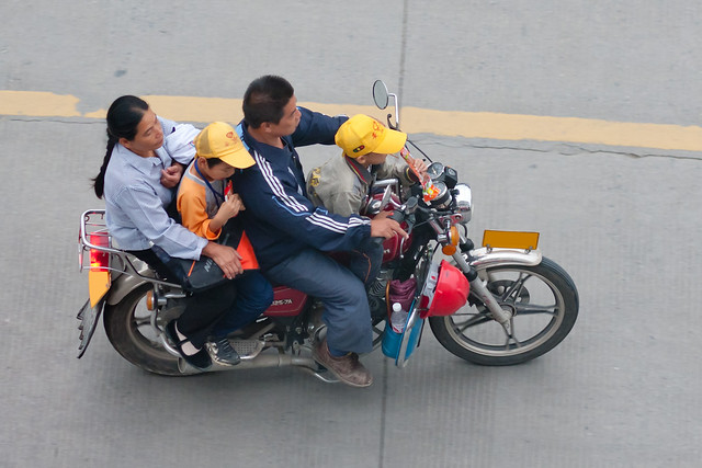 Two adults and two kids (!) on a motorcycle in Yangshuo, Guilin
