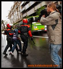 Uno de los detenidos (Soniko   Kaleko Begiak) Tags: sahara cops country protest police bilbao protesta marruecos riots basque polisario vasco euskadi bilbo pais frente saharauis saharaui euskal herria ertzaintza rasd askatu incidentes