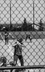 Kate Burton1 (byuiphotography) Tags: photography narrative blackandwhite field softball team runner batter ball byui