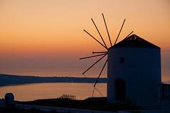 Sunset on Oia (adeschenes) Tags: 2016 aegean coastline cyclades dusk greece greekisland island k7 landscape mill oia oiasunset orange pentax red santorini sea seaside sky sunset thira water windmill