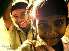 A Thousand Splendid Suns (Ishan Aranjikal) Tags: light boy portrait india girl smile childhood kids children golden war peace shine play joy kittens bombay flare cheer laila mumbai playful tariq sonycybershot goldenlight athousandsplendidsuns ishanaranjikal 20october2009