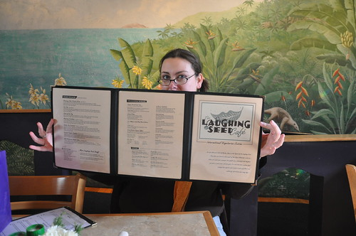 Katy holding the menu from The Laughing Seed, Asheville, NC