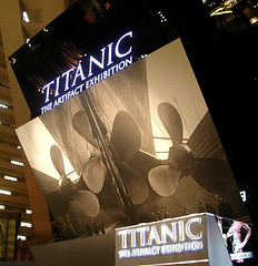 poster for the titanic exhibit showing the three propellers