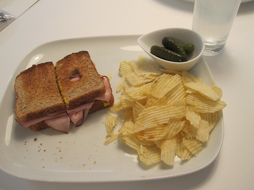 Ham sandwich, chips, pickles