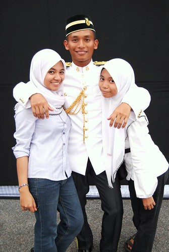 With his younger sisters