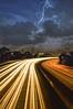 Anvil Crawler (Lee Sie) Tags: city longexposure storm bulb night clouds dark lights downtown cityscape traffic i5 sandiego freeway thunderstorm interstate lighttrails lightning streaks northbound blackness nikond40