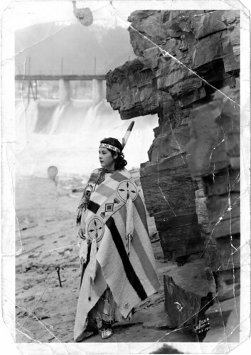 Native American woman, standing alone by cliff by DPL Western History/Genealogy