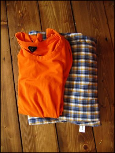 orange long sleeve tee and pyjama bottoms