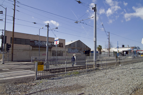 "A pedestrain enters the Washington Station illegally, walking near the tracks an well within the ""danger zone""."