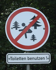 Use toilets! [Explored] (bhiphotography | Felix Straube) Tags: nature sign forest warning funny forrest parking dont crap use stick figures toilets prora