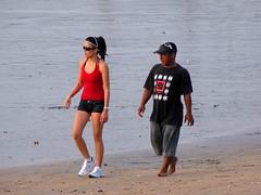 Kuta beach (Mangiwau) Tags: sunset bali beach girl beautiful lady female walking indonesia asian golden scenery fitness indonesian escort pantai kuta strolling cantik olahraga cewek fitnes pante
