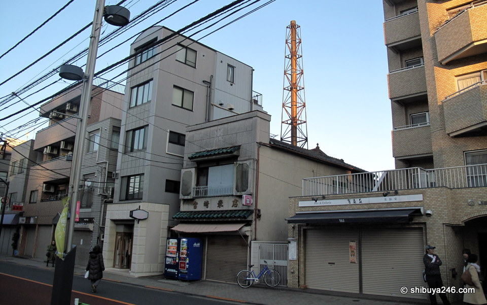 Looks like a public bath house or onsen tower here.