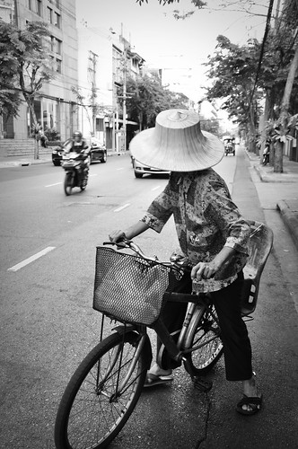 Hattedwomanonbicycle
