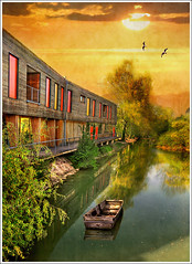 Orange Windows (Jean-Michel Priaux) Tags: sunset orange sun sunlight lake france tree nature water architecture photoshop river painting boat construction flood dream lac calm rivière peinture dreaming ill reflect alsace paysage hdr barque anotherworld étang savage sauvage ried marécage priaux muttersholtz ehnwihr digitalflood maisondelanature constructionenbois
