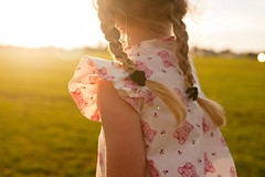 monday eve (Le Fabuleux Destin d'Amlie) Tags: sunset portrait test girl childhood vintage ball lens three kid toddler child play dress pentax outdoor review explore getty braids newcamera limited aotearoa plaits forme dpc bloomers sportsfield k7 31mm exploreflickr pentaxk7 familygetty2010 stwell stsell