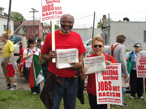 Abayomi Azikiwe, editor of the Pan-African News Wire and Kris Hamel, managing editor of Workers World, at Patton Park for the May Day demonstration in Detroit. Thousands marched in support of immigrant and workers rights. (Photo: Bryan Pfeifer) by Pan-African News Wire File Photos