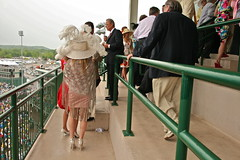 THE 136TH. RUNNING OF THE KENTUCKY DERBY: MILLIONAIRES ROW, CHURCHILL DOWNS, LOUISVILLE, KY, 1 MAY 2010 (louisbickett) Tags: horses men feet racetrack children spring hands women highheels lexington ky hats louisville beautifulpeople churchilldowns cellphones bowties womeninhats meninsuits meninglasses marycampbell meninties havilandargoiii archivelouiszoellarbickettii louiszoellarbickettii georgehavilandargoiii 1may2010 judypatton phylissgeorge biffcampbell bobbabbage laurababbage the136thrunningofthekentuckyderbymillionairesrow peopletalkingonthephone meninbeards