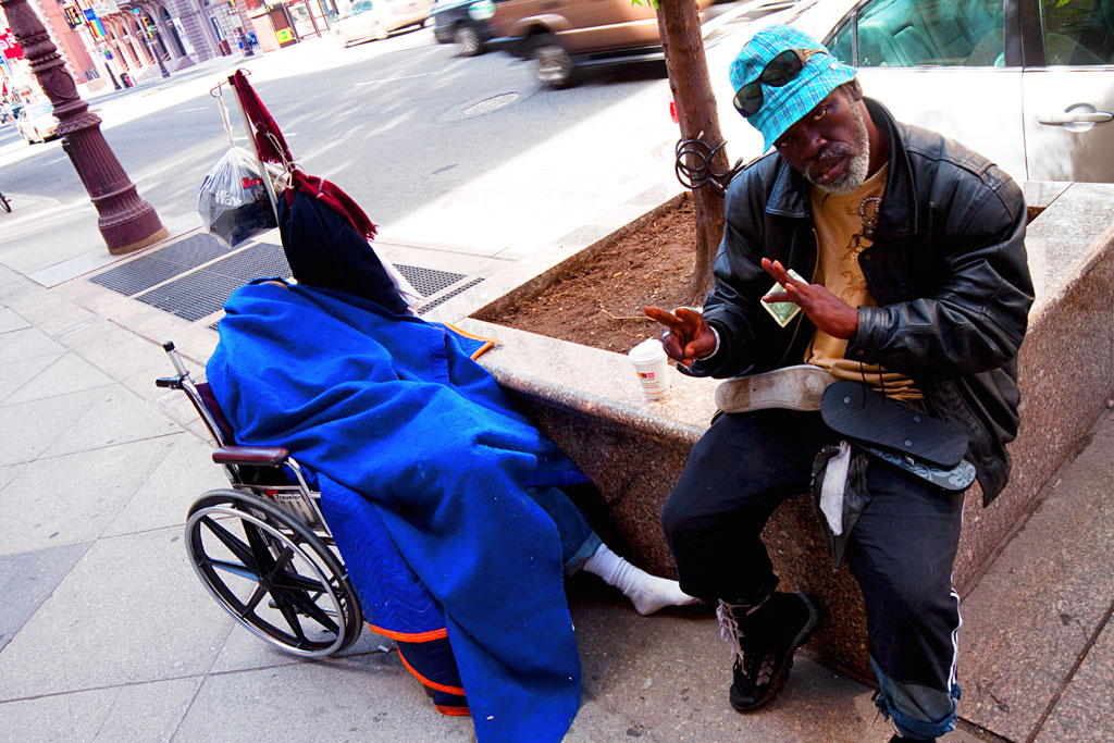 Man-sleeping-on-wheelchair--Center-City-3
