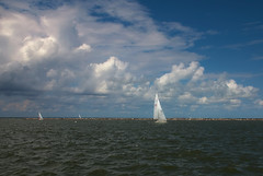 Sailboat and Sky (frankhg) Tags: ocean blue sky white water clouds sailboat boat nikon waves wind jetty sail d80 frankhg
