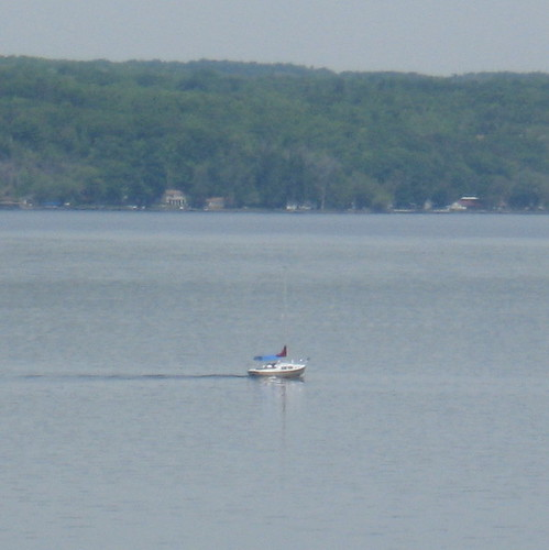 Sailboat chugs north on Seneca Lake