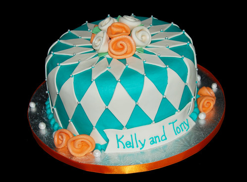 Turquoise and Orange Diamond Patterned Bridal Shower Cake with ribbon roses and pearls