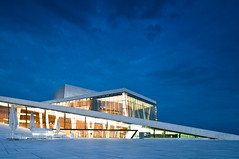 The Oslo Opera House (John Erik) Tags: wood blue light summer sky ballet inspiration snow green ice nature glass yellow oslo norway stone architecture night clouds lights golden design norge spring nikon opera dusk angles granite glowing fjord iceberg nikkor scandinavia havn materials gamlebyen oslofjord oslofjorden grnland d300 operaen gnd snhetta bjrvika snoarc oslooperahouse flickrgolfclub graduatedfilters 1024mmf3545g hitech100