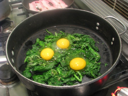 Eggs on the spinach