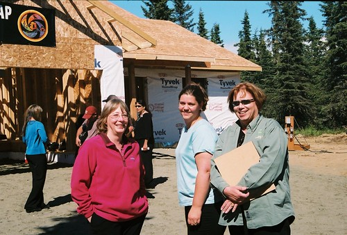 Left to right:  USDA Rural Development staff Michelle Hoffman, Amy Milburn and Wylie Chandler stand in front of a home being constructed with USDA funding support.