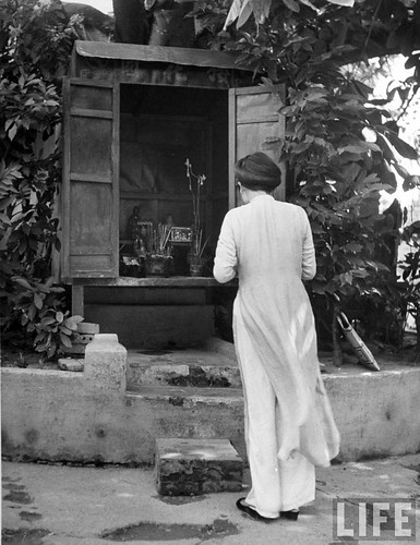 Hanoi 1948 - Native attending services in small Buddhist Temple.