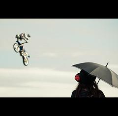 At a Show (Woman) (camerafool) Tags: show sky woman hat bike rose japan lady umbrella dark tokyo nikon amazement anonymous spectator motorcross singleexposure d3000