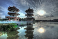 Twin Pagodas, Chinese Garden (badzmanaois) Tags: sunset lake tree clouds reflections reeds pagoda twilight cloudy buddhism zen serenity flare chinesegarden sunrays riverbank classicalarchitecture chinesearchitecture religiousbuilding orientalarchitecture oneofthemostbeautifulplacesonearth orientalpagoda gettyimagessingaporeq1