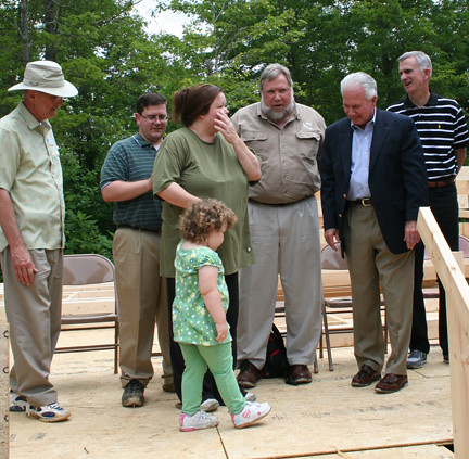 Kentucky State Director Tom Fern (second from right) congratulates new homeowner Kristi Wilson, who was selected=
