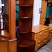 Tall slim mahogany corner shelf unit E80