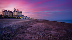 Purple blast (SpectrumLight) Tags: landscape coastline coast beach hotel queenshotel eastbourne eastsussex england sunset twilight dusk pink sky purple pebble seascape seaside summer flickr sonya7ii sonyilce7m2 fe1635mmf4zaoss wideangle waterfront