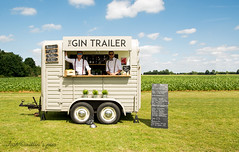 The Gin Trailer (Just Caitlin) Tags: gin trailer thegintrailer field green sky blue clouds white sign chalk hipster different ruleofthirds wheel wood alcohol man 2