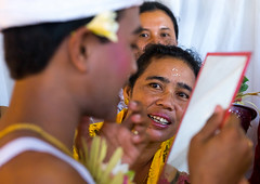 Teenage boy looking at her new teeth in a mirror during the the tooth filing ceremony, Bali island, Canggu, Indonesia (Eric Lafforgue) Tags: anxiety asia asian bali bali2631 balinese beliefs canggu ceremony clothing colorimage customs dentist family filing groupofpeople headwear hindu hinduism horizontal incisor indigenouspeople indonesia indonesian indonesianculture manusa mesangih mirror pain painful painfully realpeople rite riteofpassage rites ritual spiritual teeth tooth tradition traditional traveldestination women baliisland