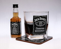 JD and Coke (Richard Cowdrey) Tags: glass canon eos bottle cola drink whiskey coke tennesse jd coaster jackdaniels oldno7 400d richardcowdrey