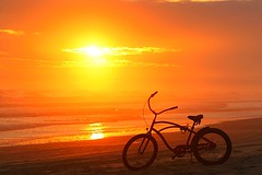Sunset Cruiser (JGetsinger) Tags: ocean sunset sea orange seascape beach bike landscape nc scenic cruiser emeraldisle beachcruiser jaygetsinger
