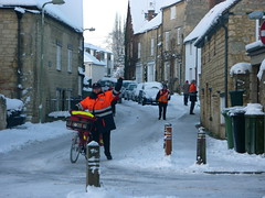 Busy Postmen (Postpeople?) (allispossible.org.uk) Tags: winter england white snow cold bicycle frost glow village january sunny postal oxfordshire 2010 postman ornage postie wheatley postmen buys posties postwoman onyerbike