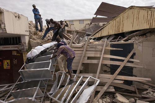 Haitians Retrieve Deceased from Collapsed Building by United Nations Photo.