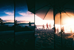 Chilling Under the Sun (Kara Hizon) Tags: sea sun film beach umbrella xpro supersampler sand glare fuji slide velvia crossprocessing boracay