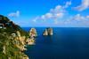 Faraglioni (Capri, Campania, Italy) (AndreaPucci) Tags: sea italy clouds island capri italia nuvole day mare campania clear isola faraglioni canoneos400 canonefs1855mm3556 natureselegantshots andreapucci