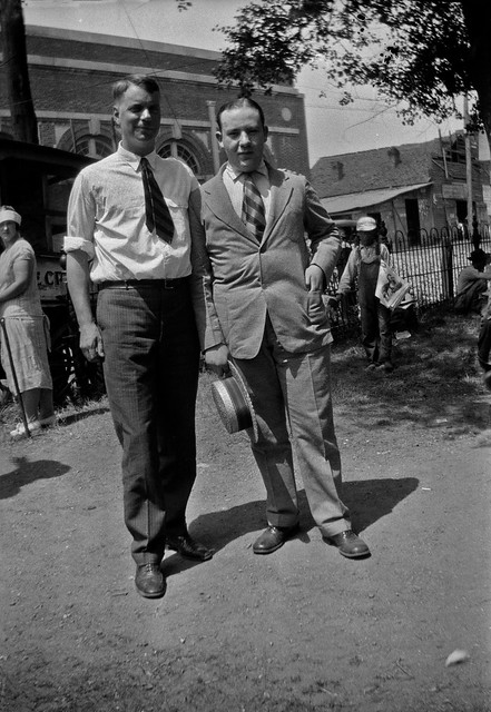 College student William Silverman (at right), standing with his former high school teacher, on the lawn of the Rhea County Courthouse, Dayton, Tennessee, July 1925.