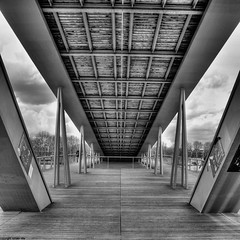 sous la passerelle (romvi) Tags: bridge people bw white black paris france architecture clouds de nikon europe noir simone perspective nb villa pont 12 nuages bercy et arrondissement blanc romain dri gens 12eme tolbiac passerelle beauvoir d90 passerellesimonedebeauvoir romainvilla romvi