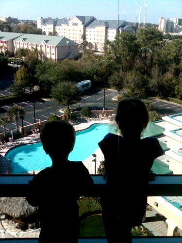 Kids looking out window of Crowne Plaza Orlando