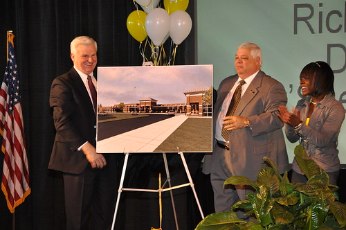 Darryl Rosser, CEO of the Chicago furniture company that supplied new furniture for the J.V. Martin Junior High School, Dillon County school board chairman Richard Schafer and Ty'Sheoma Bethea unveil plans for the new school funded by USDA Rural Development.