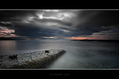 Brooding (Spiritflier) Tags: longexposure sunset sea sky bw clouds canon eos interestingness aberystwyth explore northbeach 7d grad ceredigion 79 breakwater carbonfibre cokin giottos 10stop nd110 zpro spiritflier simoore