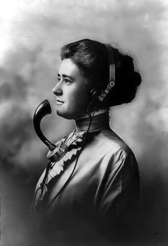 A telephone operator circa 1911.