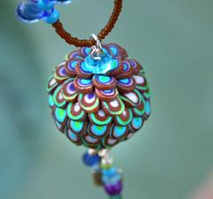peacock4 (purplecactusstudios) Tags: blue flower fun lotus funky clay bud whimsical polymer