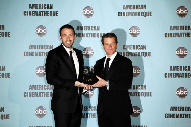Matt Damon receiving award from Ben Afleck by rufloresphoto